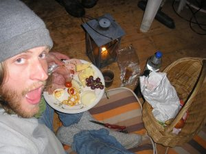 Dinner by candle-light in a gartenhaus. This is classic German hosipitality - a massive plate of loads of different types of cheese and meat and piles of bread and such (in the basket). This is in Eberbach.